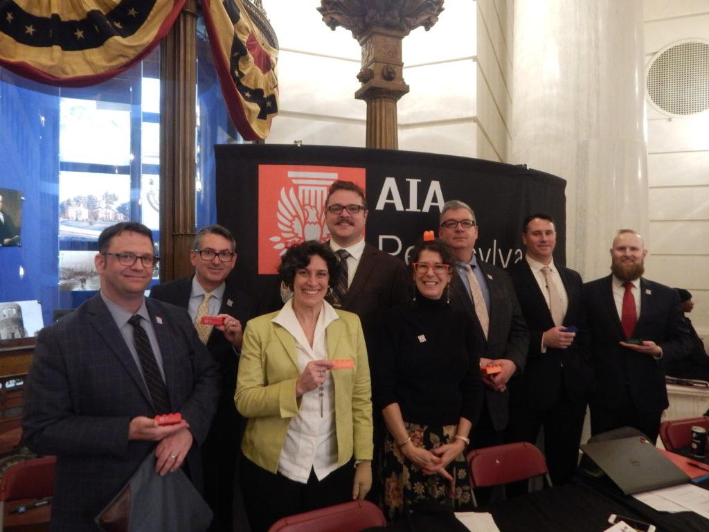 Members pose with legislative leave behind legos